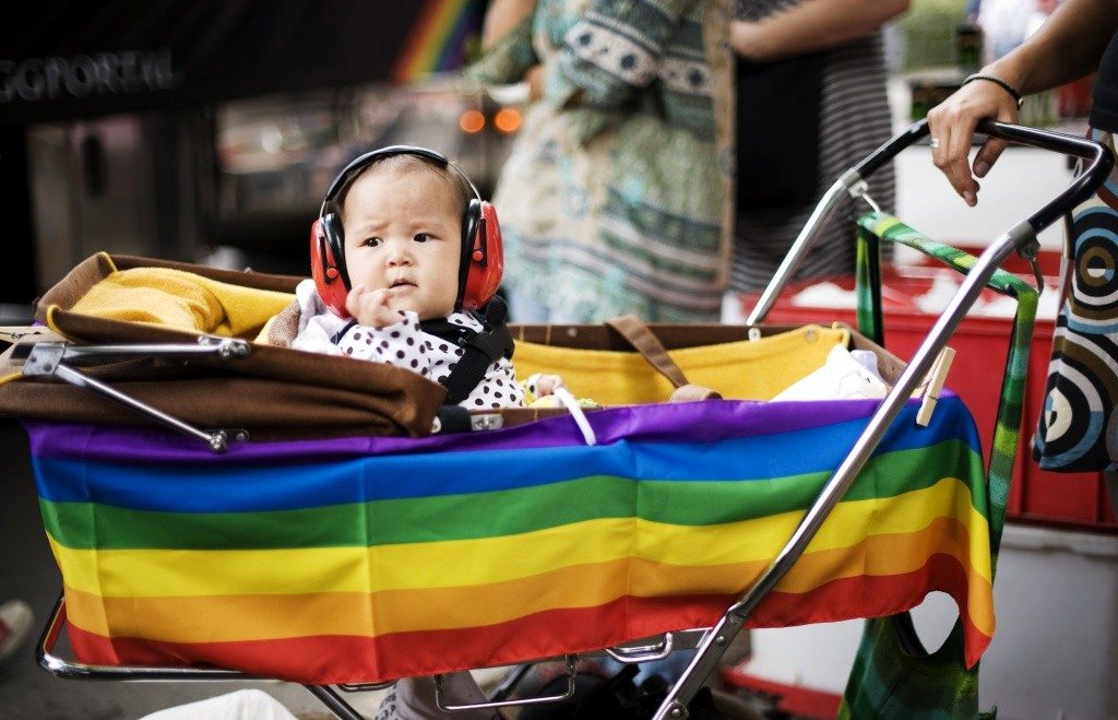 "A child with ear-protection gear looks on during the HBTQ festival ""Stockholm Pride"" parade on August 6, 2011 in central Stockholm. AFP PHOTO / JONATHAN NACKSTRAND (Photo credit should read JONATHAN NACKSTRAND/AFP/Getty Images)"