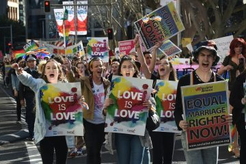 Supporters of same-sex marriage shout slogans as they take part in a rally in Sydney on August 9, 2015. Thousands of people rallied in Australian cities this weekend in support of same-sex marriage, as politicans across multiple parties prepared to table a bill to make the unions a legal right. AFP PHOTO / Peter PARKS        (Photo credit should read PETER PARKS/AFP/Getty Images)